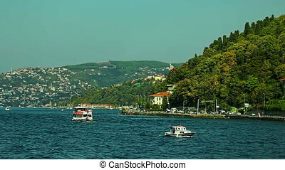 Boats sails Bosphorus on sunny autumn day