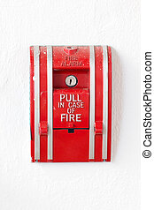 Red fire alarm pull switch isolated on white