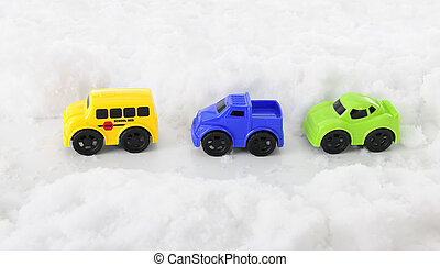 Toy Vehicles through a Snowy Pass - High view of three toy...
