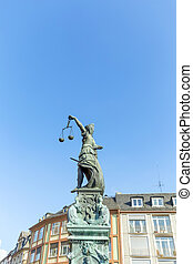 Statue of Lady Justice, fountain of justice in front of the...