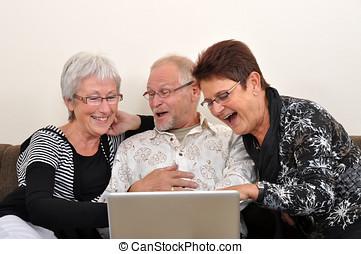Exploring the web - Seniors man and women exploring the web