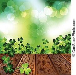 Shamrock on wooden floor with green bokeh for St. Patrick's...