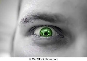 Serious sad and angry looking man with green eye