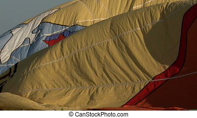 Fabric of hot air balloon flying in wind