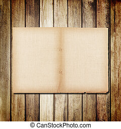 old paper on brown wood texture with natural linen textured
