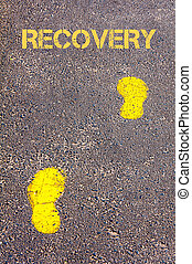 Yellow footsteps on sidewalk towards Recovery message,...