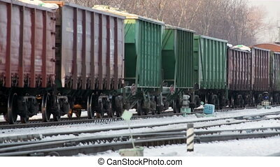 cargo train move on snow rail road in winter russia