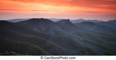 Dawn over the mountains with clouds - Landscape. Dawn over...