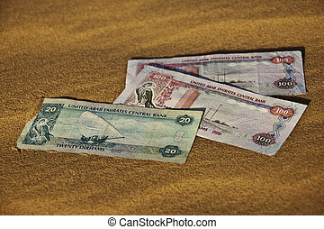 United Arab Emirates Dirham currency bank notes laying on...