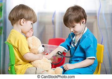 kids play doctor with plush toy - kids brothers playing...