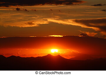 Western Orange - The sun setting in the western skies near...
