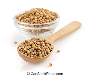 coriander spices in spoon on white - coriander spices in...