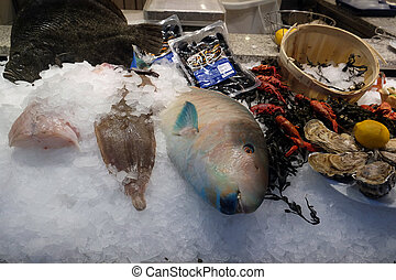 Fish and seafood prepared for sale in Nordsee restaurant...