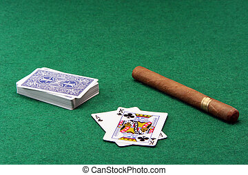 gabmling and cigar - gambling ace with king stack of cards...