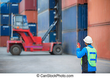 foreman control forklift handling the container box load to...
