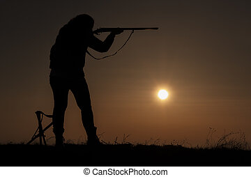 Women in hunting sunset