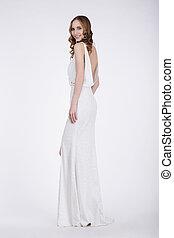 Luxurious Woman in Long Dress Posing