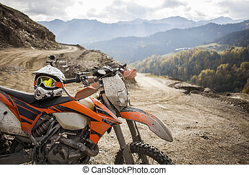 Dirty enduro motorcycle motocross helmet on road - Offroad...