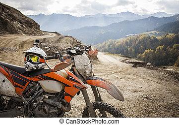 Dirty enduro motorcycle motocross helmet on road - Offroad...