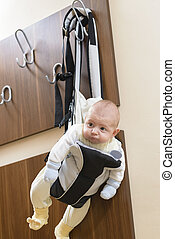 Baby in a hanger - Cute baby sitting in a front baby carrier