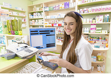 Young Female Pharmacist - Young female pharmacist holding a...