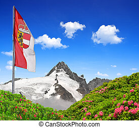 Grossglockner with flag of Salzburg ,Austria