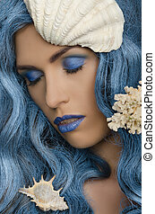 woman with blue hair and seashells with eyes closed