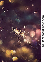 Sparkler and Colorful Bokeh - Holiday background with bright...