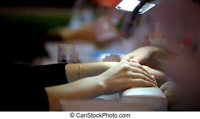 Client waiting for manicure in beauty salon. Womans hands close up. HD. 1920x1080