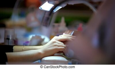 Manicurist doing the polishing female fingernails. HD....
