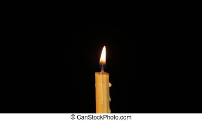 Wax candle flares on a black background.