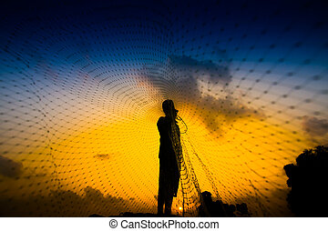 Casting a silhouette at sunset on the lake, Thailand