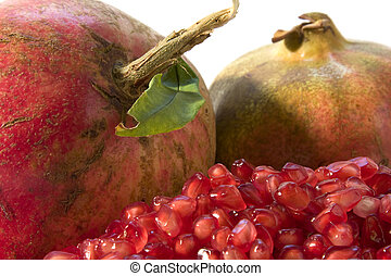 Pomegranate close up - Red ripe pomegranates with grain on...