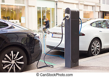 Electric Cars in Charging Station. - Power supply for...