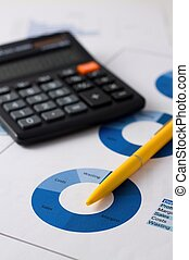 Yellow pencil placed on blue pie chart - Vertical photo of...