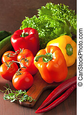 healthy vegetables pepper tomato salad chilli on rustic backgrou
