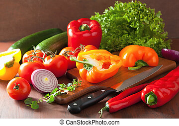 chopping healthy vegetables pepper tomato salad onion chilli on