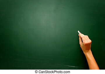 Female teen hand to draw something on blackboard with chalk...