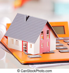 Close up Miniature House on Top of a Calculator - Close up...