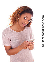 African American young woman sending a text message on her...