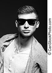 Portrait of handsome young man wearing sunglasses Black and...