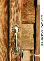 door handles on a brown wooden door
