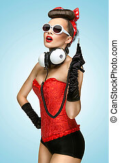 Pin-up party. - The pin-up photo of a cute girl in...