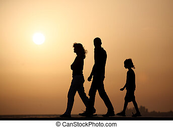 silhouette of young family