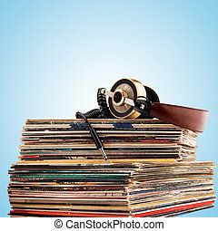 Headphones and vinyl records. - Retro headphones for...