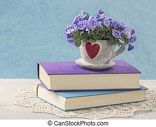 Pile of books and flowers