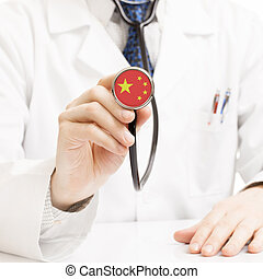 Doctor holding stethoscope with flag series - Republic of...