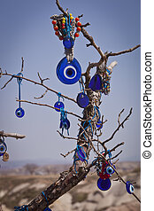 Turkish Evil Eye on a Tree - Turkish evil eye hanging from...