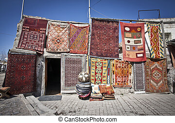 Turkish Rugs Hanging in a Market