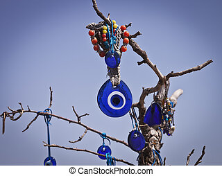 Evil Eye - Evil eye hanging from a branch in Cappadocia...